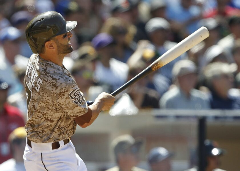 San Diego Padres' Will Nieves hits a grand slam during the fourth inning of a baseball game against the San Francisco Giants in San Diego, Calif., Sunday, April 12, 2015. (AP Photo/Alex Gallardo)