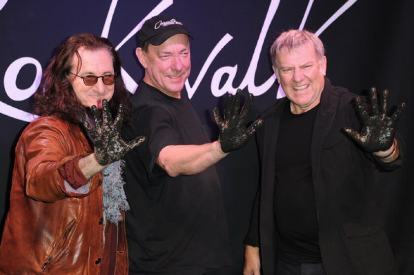 Canadian progressive-rock band Rush, here getting their handprints set in concrete at Guitar Center in Hollywood, lead fan voting for Rock and Roll Hall of Fame induction