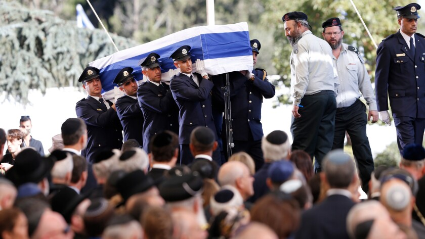 Knesset guards carry the flag-draped coffin during the funeral for former Israeli President Shimon Peres at the Mount Herzl national cemetery in Jerusalem on Friday.