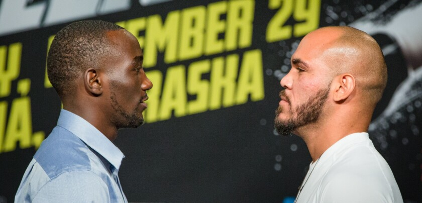 Ray Beltran, right, and Terence Crawford are shown at a news conference in 2014 in Omaha.