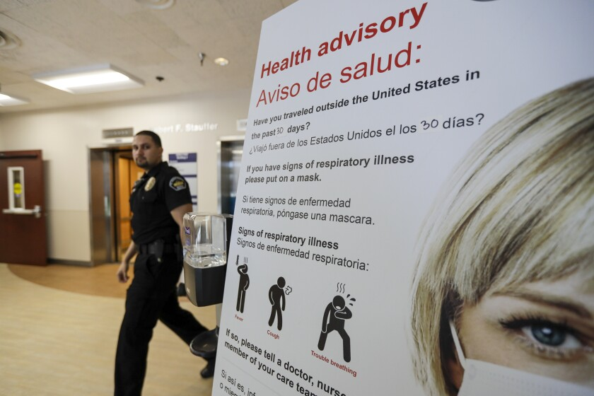 Coronavirus health advisory posted at St. Joseph Hospital in Orange