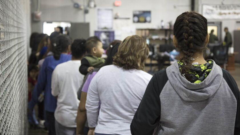 Migrants line up for processing at the U.S. Customs and Border Protection facility in McAllen, Texas, in June 2018.