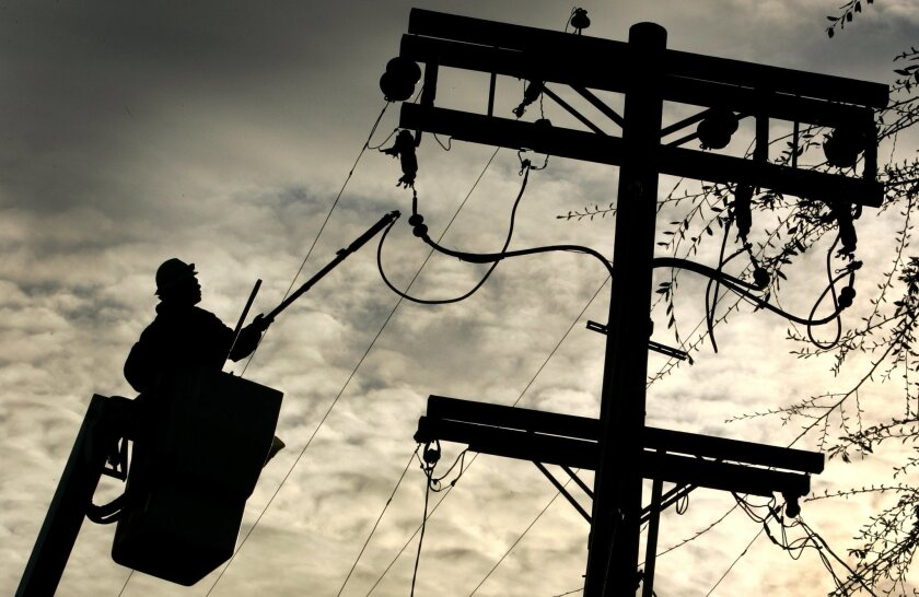 A lineman at work on a downed power line.
