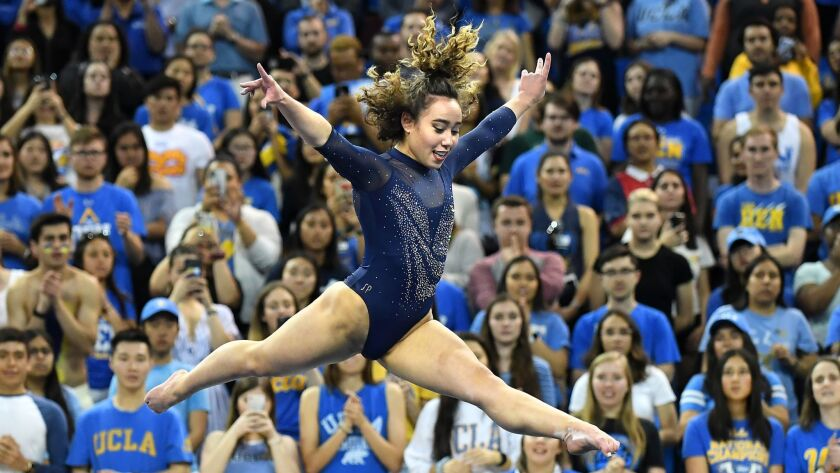 LOS ANGELES, CALIFORNIA MARCH 21, 2019-UCLA's Katelyn Ohashi gets a perfect score on the floor exerc