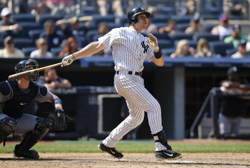 New York Yankees Mark Teixeira watches his eighth-inning solo home run in a baseball game against the Seattle Mariners at Yankee Stadium in New York, Sunday, July 19, 2015. (AP Photo/Kathy Willens)