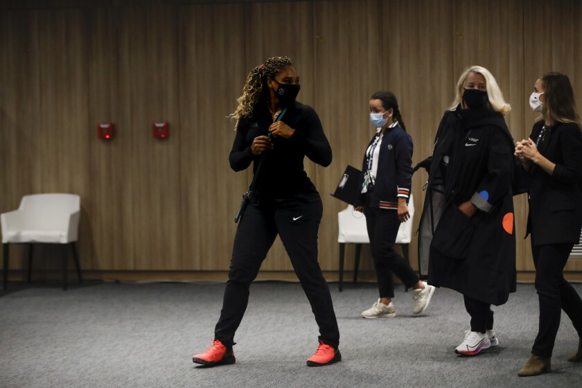 Tennis star Serena Williams leaves a news conference in Paris.