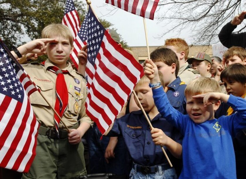 Scouts salute at a February rally in Dallas, opposing the inclusion of gays in the organization.