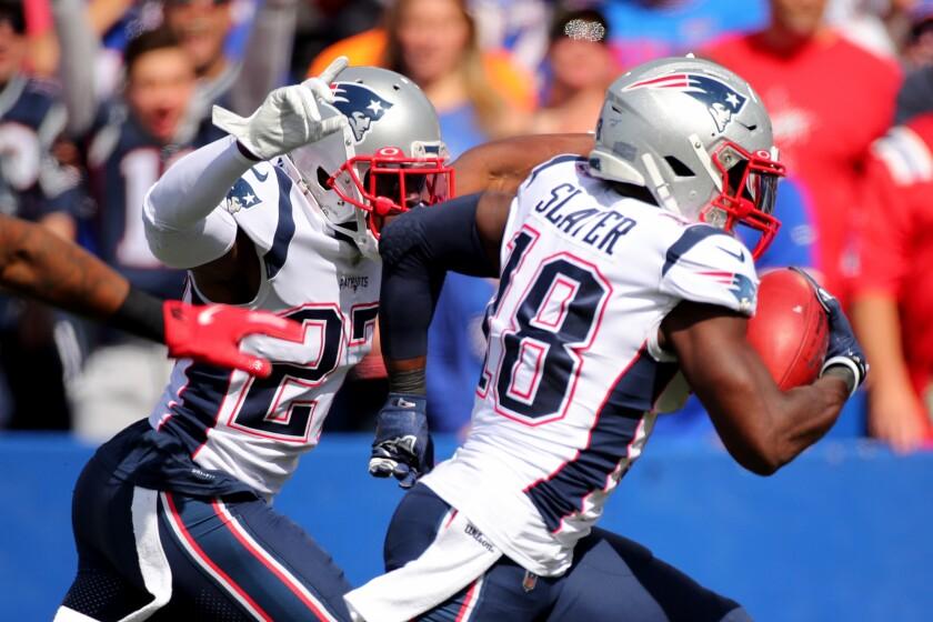 Matthew Slater celebrates as he scores a touchdown.