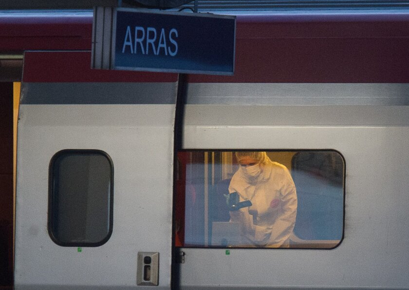 A police officer uses a video camera at a crime scene inside a Thalys train stopped at a train station in Arras, northern France, Friday, Aug. 21, 2015. A gunman opened fire with an automatic weapon on the high-speed train traveling from Amsterdam to Paris Friday, wounding several people before being subdued by two American passengers, officials said. (AP Photo)