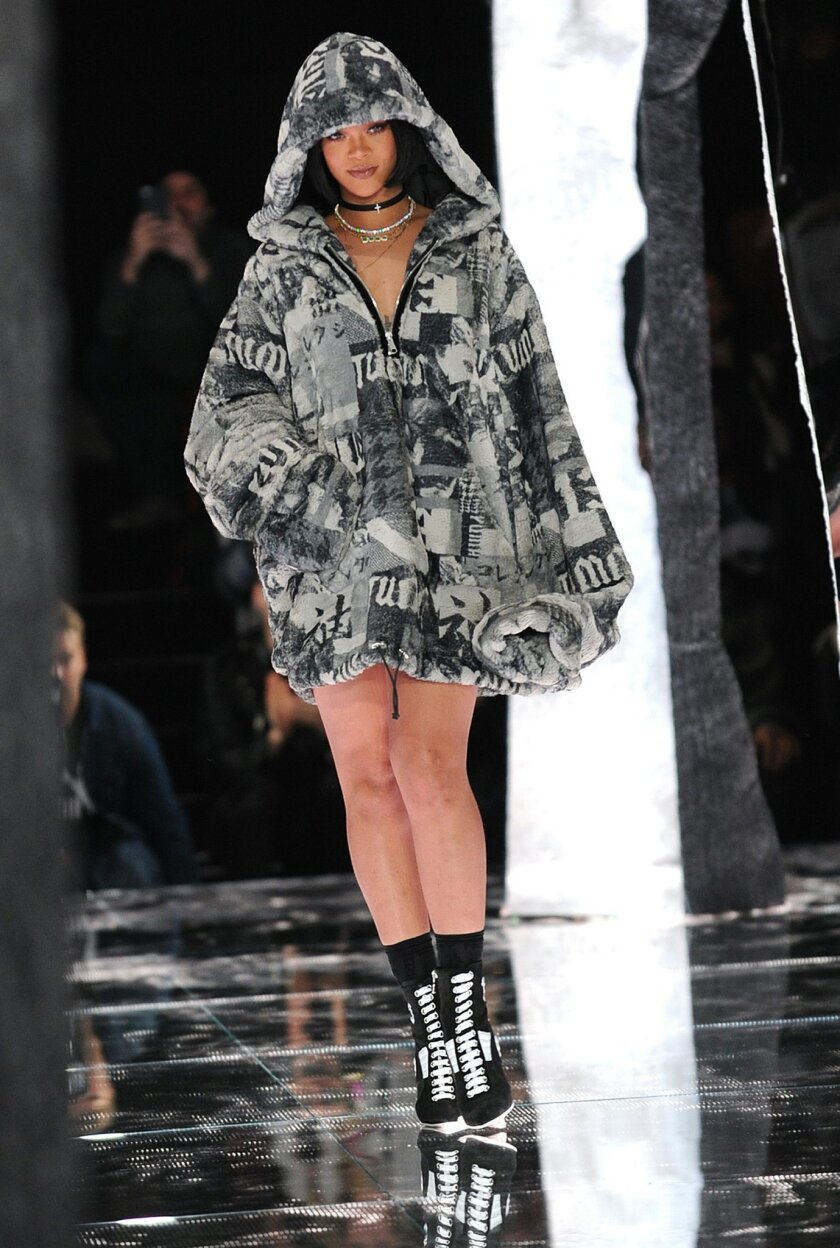 Rihanna greets the audience after FENTY PUMA by Rihanna is shown during New York Fashion Week, Friday, Feb. 12, 2016.  (AP Photo/Diane Bondareff)