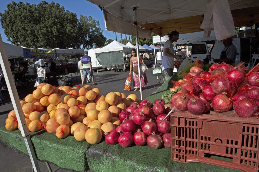 Crown 12 Ranch sells Shambar grapefruit and Angel Red pomegranates grown in Corona, at the West Hollywood farmers market.