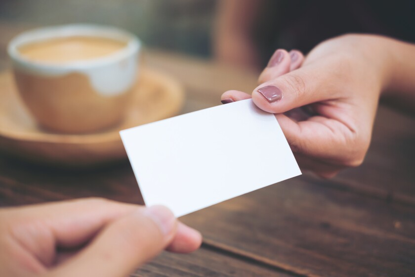 Business man giving  business card to business woman with coffee
