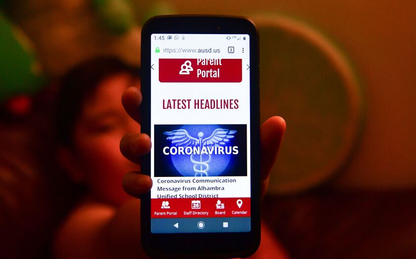Coronavirus headlines on a smartphone