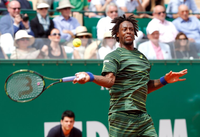 Gael Monfils of France  plays a return to Tomas Berdych of Czech Republic, during their semifinal match of the Monte Carlo Tennis Masters tournament,  in Monaco, Saturday, April 18, 2015. (AP Photo/Claude Paris)