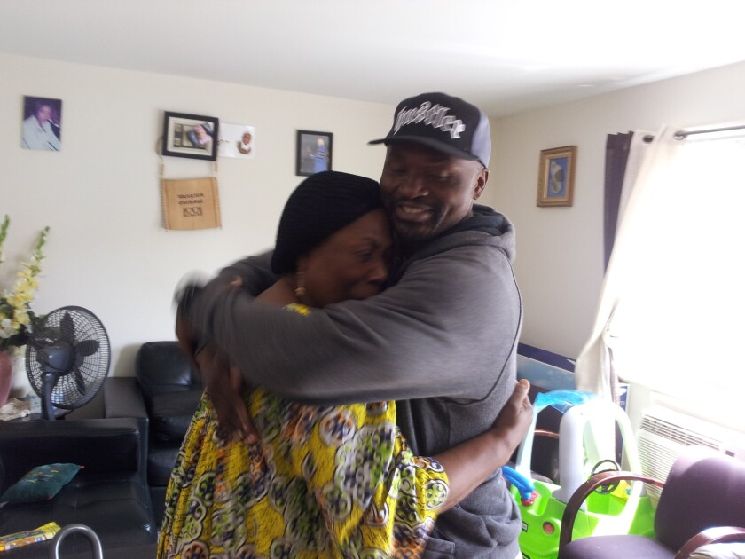 Charly Leundeu Keunang, 43, a Cameroonian national, hugs his mother, Heleine Tchayou, in 2014. Keunang was shot and killed by LAPD in the skid row area of Los Angeles on March 1, 2015.