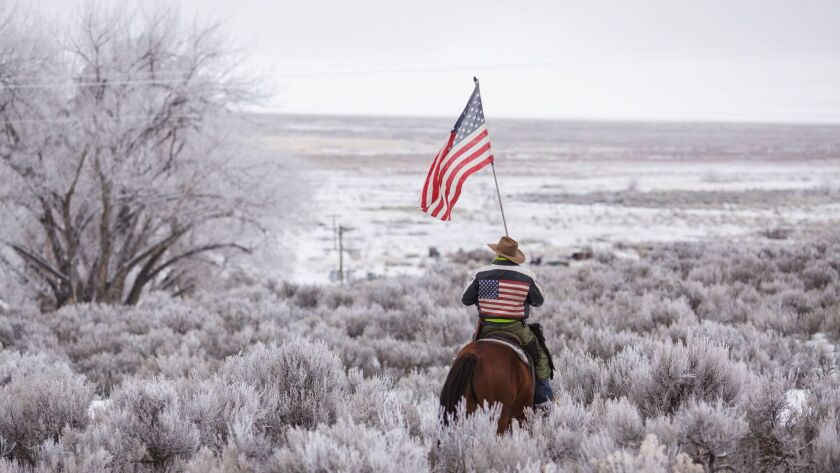 Duane Ehmer rides his horse Hellboy at the occupied Malheur National Wildlife Refuge.