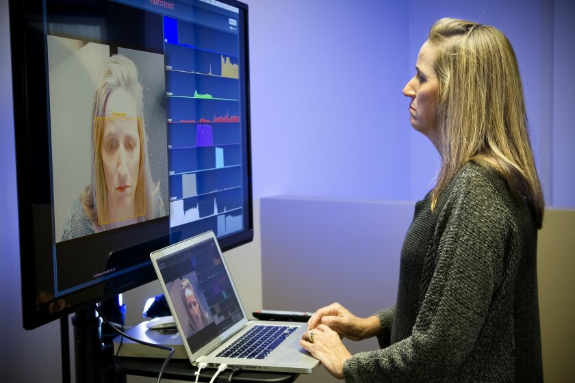 Marian Bartlett, co-founder and lead scientist at Emotient displays the software that is used to detect facial expressions.