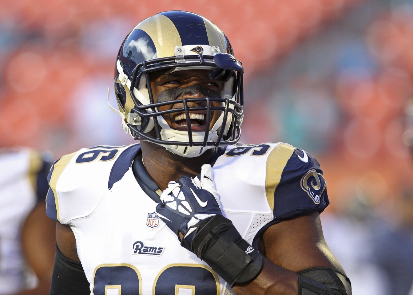 St. Louis Rams defensive end Michael Sam reacts during pregame workouts before a preseason contest against the Miami Dolphins on Thursday.