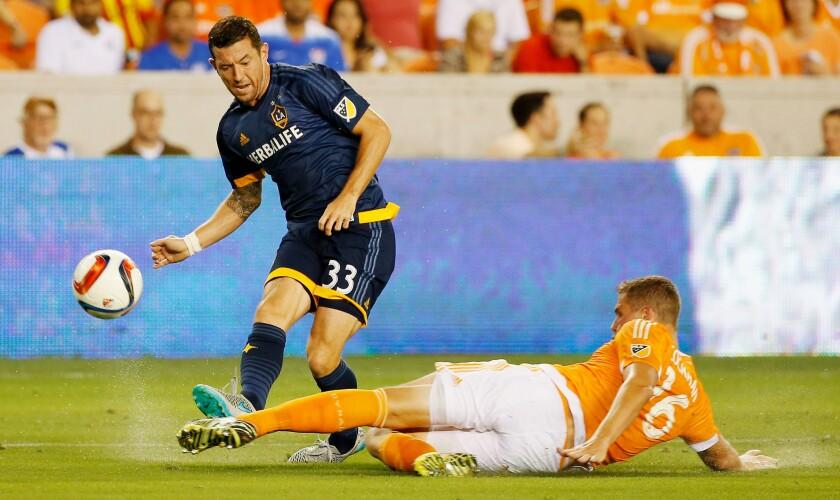 Galaxy's Dan Gargan battles for the ball with Houston Dynamo's A.J. Cochran on July 25.