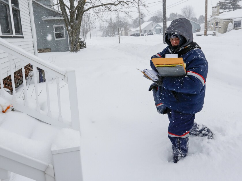 Unfazed by horrific weather in January 2019, a letter carrier makes her rounds in northern Wisconsin.