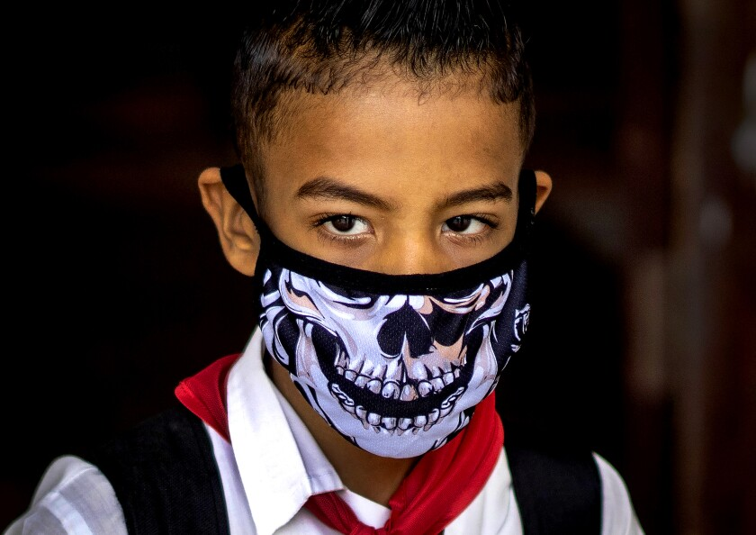 A pupil wears a face mask as a precaution against the spread of the new coronavirus in Havana.