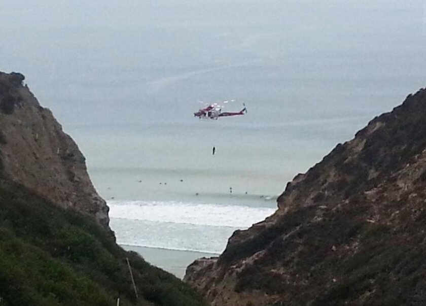 San Diego lifeguards perform multiple cliff rescues July 19 at Black's Beach due to heavy rains. Courtesy San Diego Lifeguards