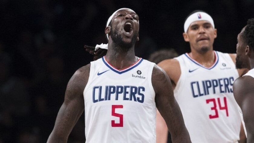 official photos d8639 7c011 Montrezl Harrell stars in Clippers' win with parental ...
