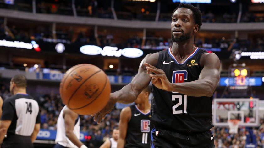 Los Angeles Clippers guard Patrick Beverley (21) throws a ball at a fan during the second half of an