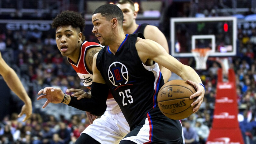 Clippers guard Austin Rivers drives against Wizards forward Kelly Oubre Jr. during a game Dec. 28.