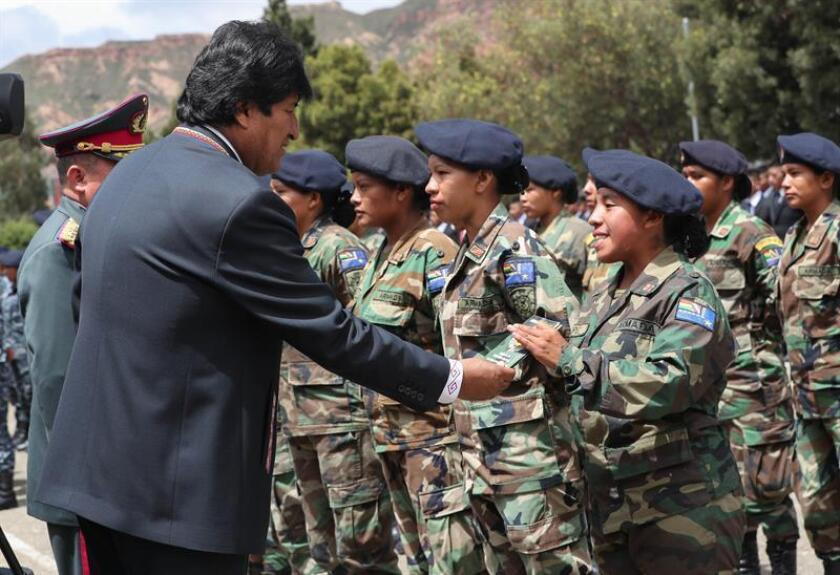 Bolivia President Evo Morales congratulates some of the first 130 women to serve in the country's armed forces during a discharge ceremony in La Paz on Tuesday, Feb. 5. EFE-EPA/Martin Alipaz