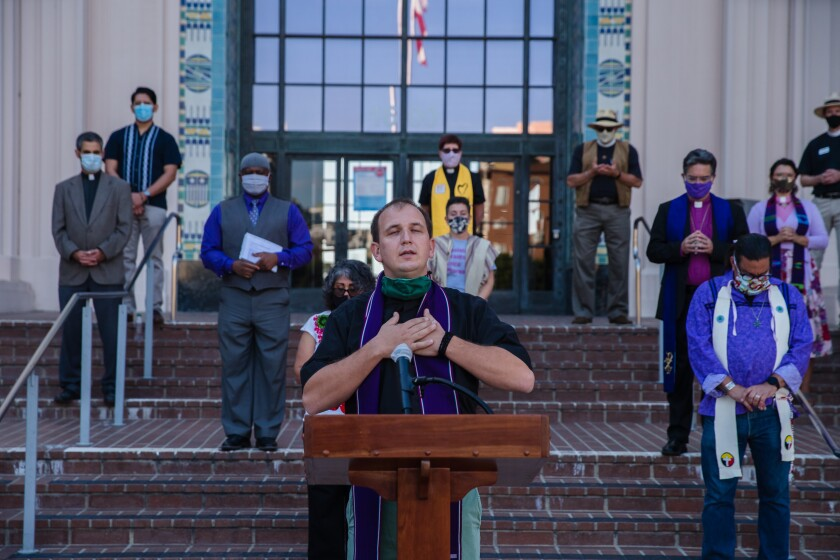 Rev. Marcus Lohrmann says a prayer in front of the San Diego County Administration Building on Nov. 1, 2020.