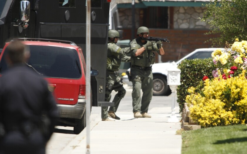 Huntington Beach SWAT officers prepare to enter a home in May 2011 in which police believed two people died in a murder-suicide.