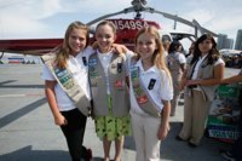 (Left) Girl Scouts: (L-R) Melissa Thomas of Rancho Santa Fe (3,009 boxes), Caroline Sanborn of Carmel Valley (2,012 boxes) and Roni Nelson of Rancho Santa Fe (4,082 boxes).
