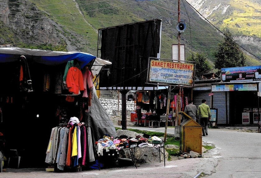 A vibrant display of woolen clothes in the empty market in Badrinath, India, in the shadow of the Himalayas. The normally busy temple town is all but deserted after devastating floods in the area last year killed thousands.
