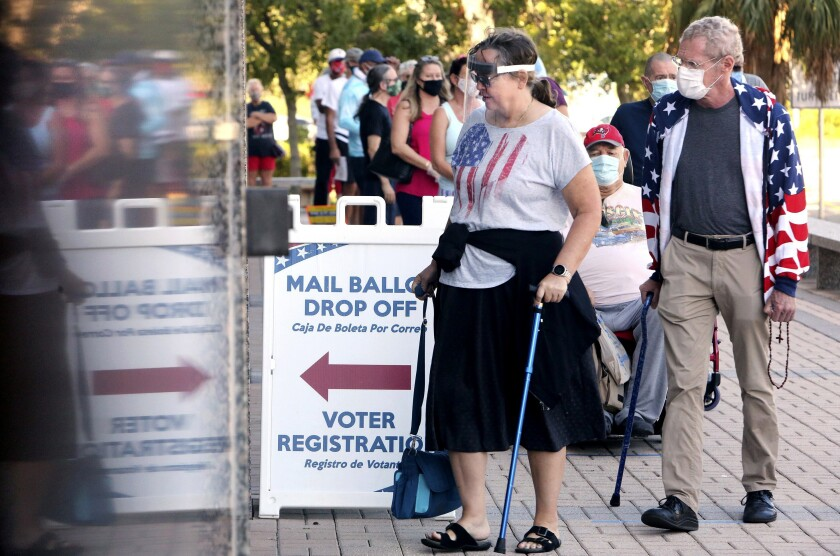 Voters wait in line to vote early in Clearwater, Fla., on Oct. 19.