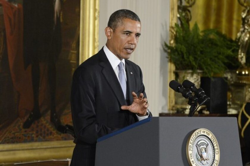President Barack Obama delivers remarks in front of a portrait of George Washington.
