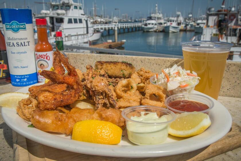 The Mixed Seafood Platter with crab cake, calamari, wild shrimp and beer-battered rock fish at Mitch's Seafood Restaurant in Point Loma.