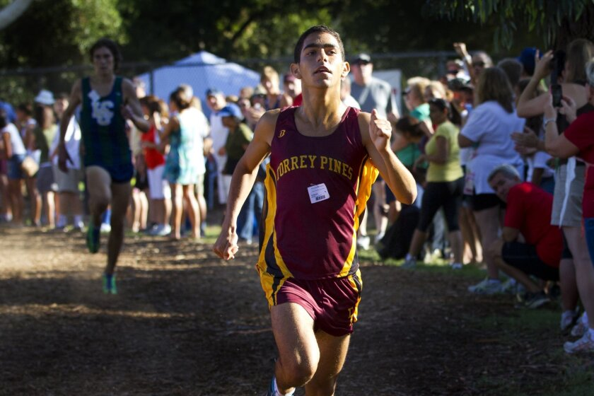 Torrey Pines' Tal Braude crosses the finish line first in what's expected to be one of several duels with Steven Fahy of La Costa Canyon.