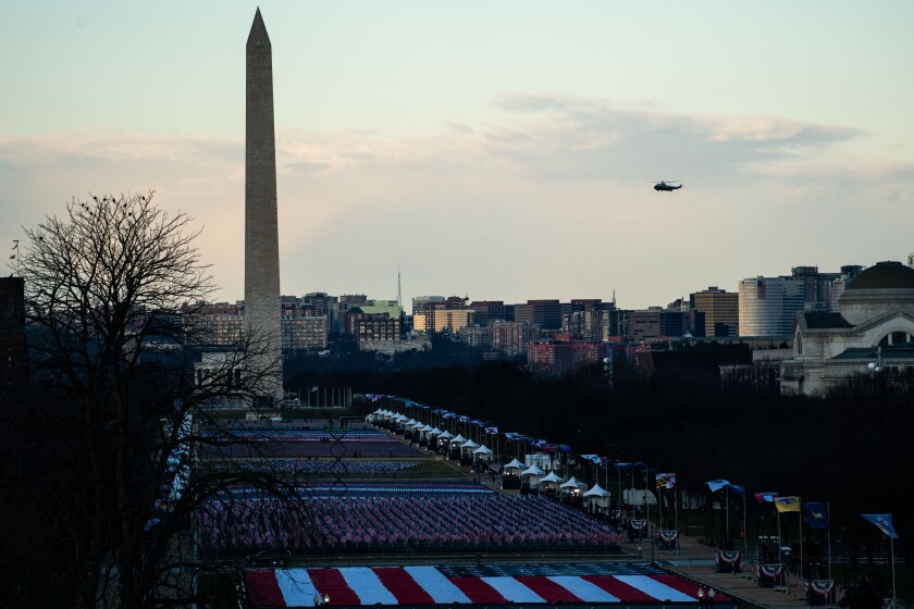 Marine One flies past the Washington Monument for the last time with President Trump aboard