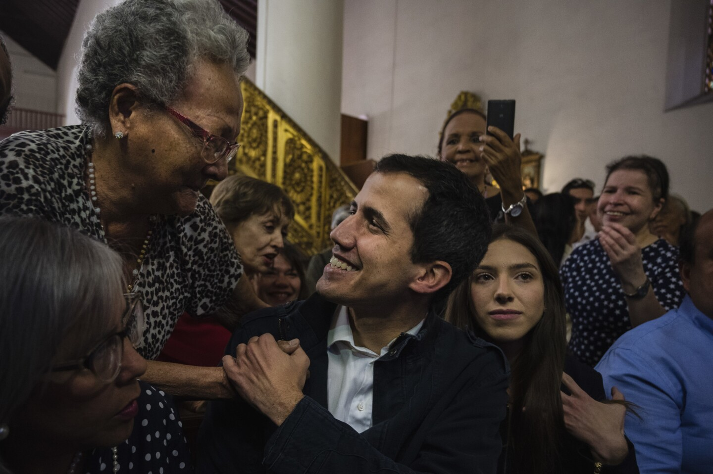 Opposition leader Juan Guaido and his family attend a Mass in honor of Venezuelans killed during the protests in Caracas, Venezuela, on Jan. 27.