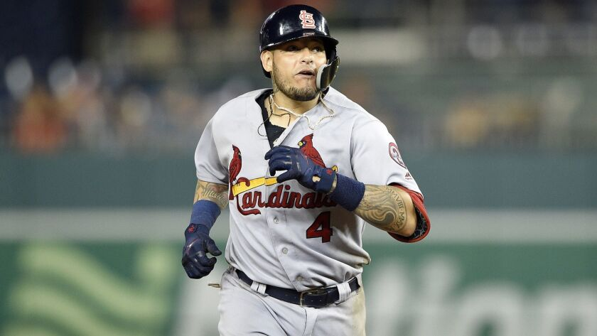 St. Louis Cardinals' Yadier Molina rounds the bases after his grand slam during a baseball game agai