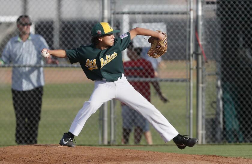 Costa Mesa American Little League No. 1 team's Isaiah Vasquez pitches against Ocean View No. 2 in a