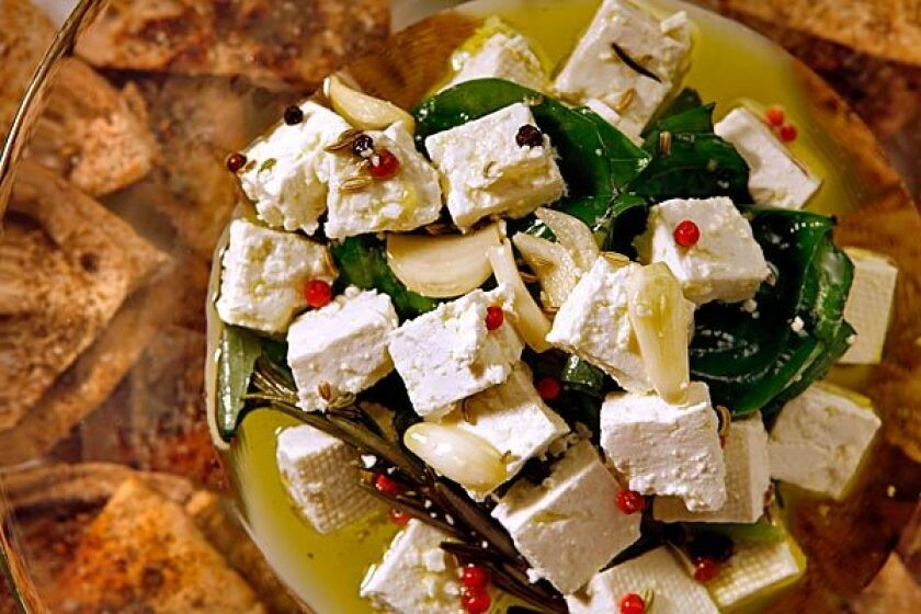 Herb-marinated feta cheese with za'tar-toasted pita triangles