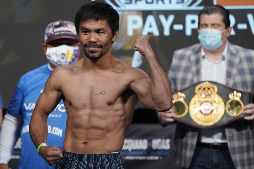Manny Pacquiao poses for photographers during a weigh-in.