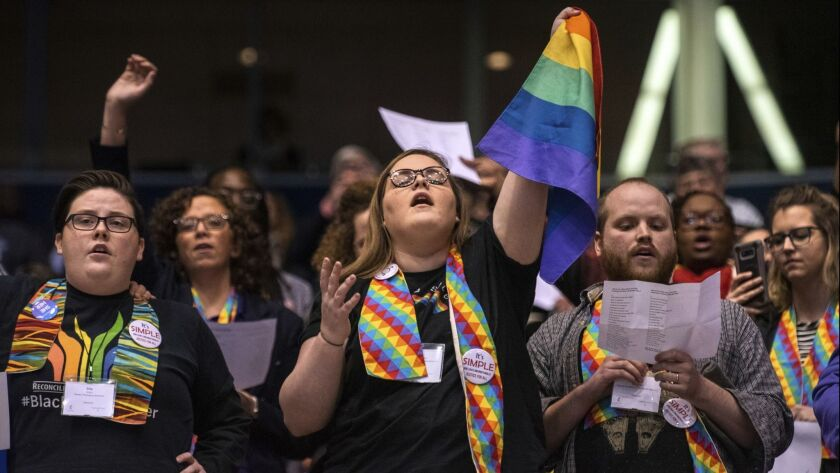 Shelby Ruch-Teegarden, center, of Garrett-Evangelical Theological Seminary joins other protestors du