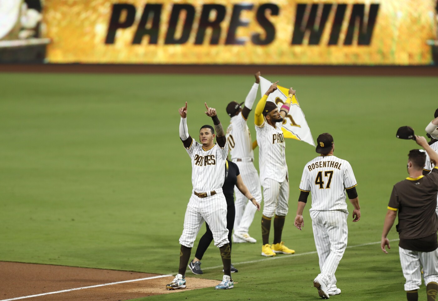 Manny Machado of the San Diego Padres celebrates after beating the St. Louis Cardinals 4-0 to win the Wild Card Series at Petco Park on Friday, Oct. 2, 2020. (K.C. Alfred / The San Diego Union-Tribune)
