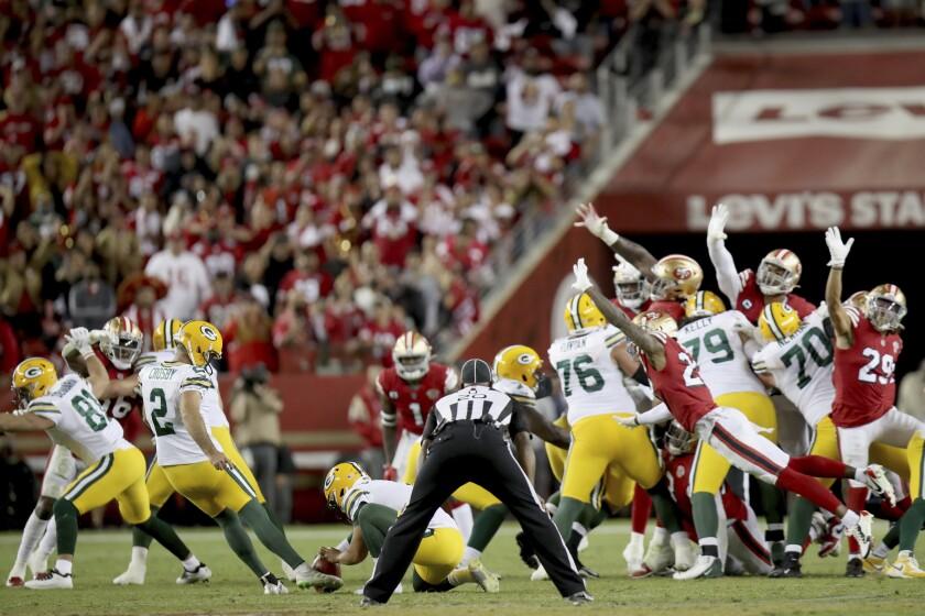 Green Bay Packers' Mason Crosby (2) kicks a