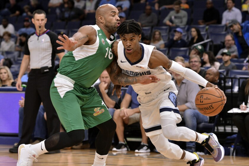Memphis Grizzlies guard Ja Morant, right, controls the ball against Maccabi Haifa guard Gregory Vargas in the first half of an exhibition NBA basketball game Sunday, Oct. 6, 2019, in Memphis, Tenn. (AP Photo/Brandon Dill)
