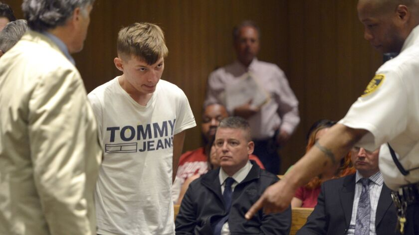 Volodymyr Zhukovskyy, 23, of West Springfield, is escorted into the courtroom for his arraignment in