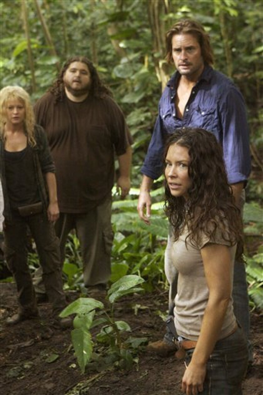 "In this TV publicity image released by ABC, from left, Emilie de Ravin, Jorge Garcia, Josh Holloway and Evangeline Lilly are shown in a scene from ""Lost."""